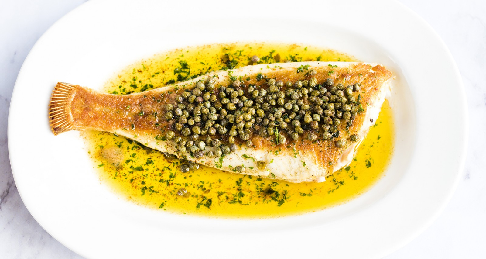 Whole roast plaice, capers, brown butter